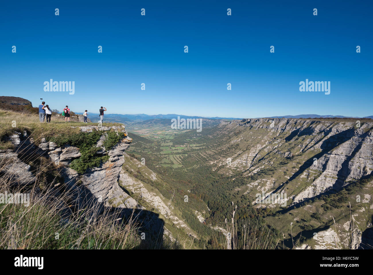 Tourist visiting famous viewpoint Salto del nervion in Burgos, Spain. - Stock Image