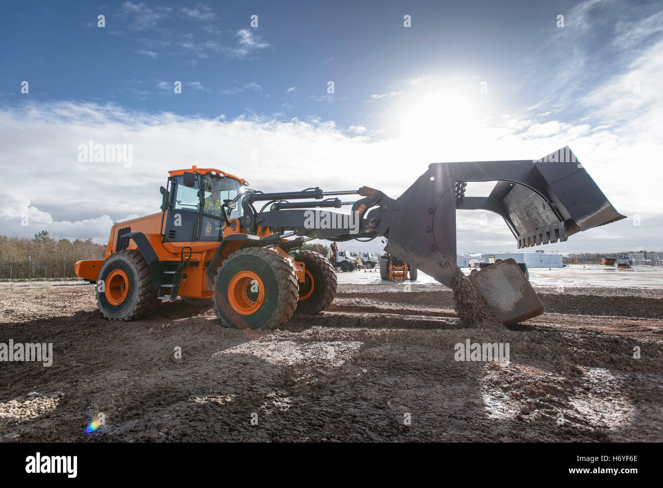 Emergency Response Team digger lifting blocks in training exercise  Image downloaded by   at 4:22 on the 14/06/15 - Stock Image