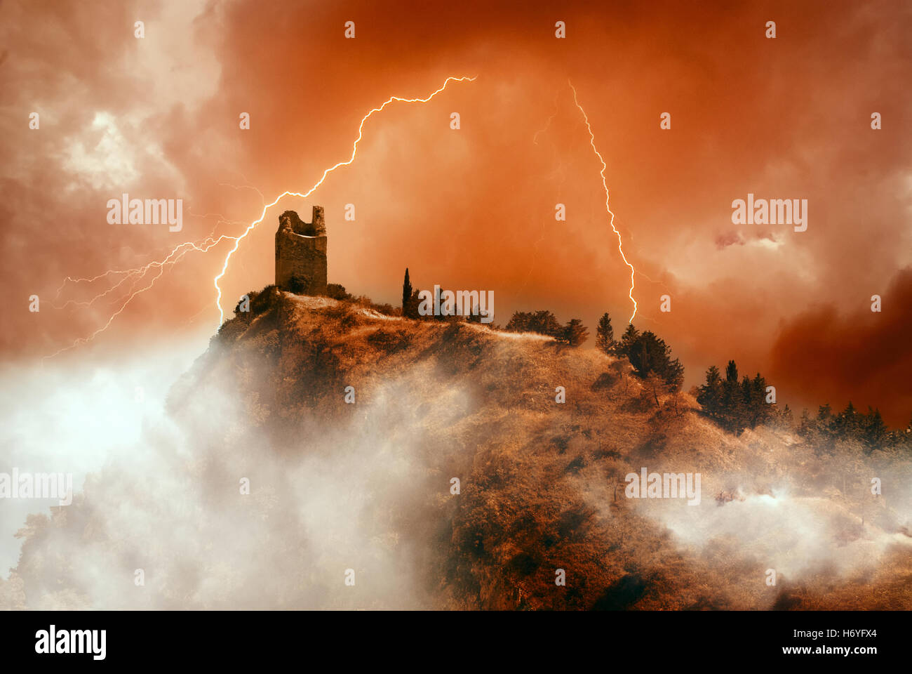 old tower on the mountain with lightning - Stock Image
