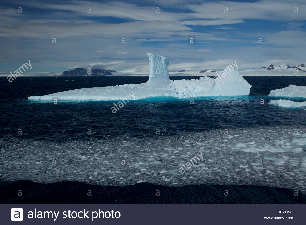 Iceberg with tower, shaped like a submarine, in the Antarctic Sound. - Stock Image