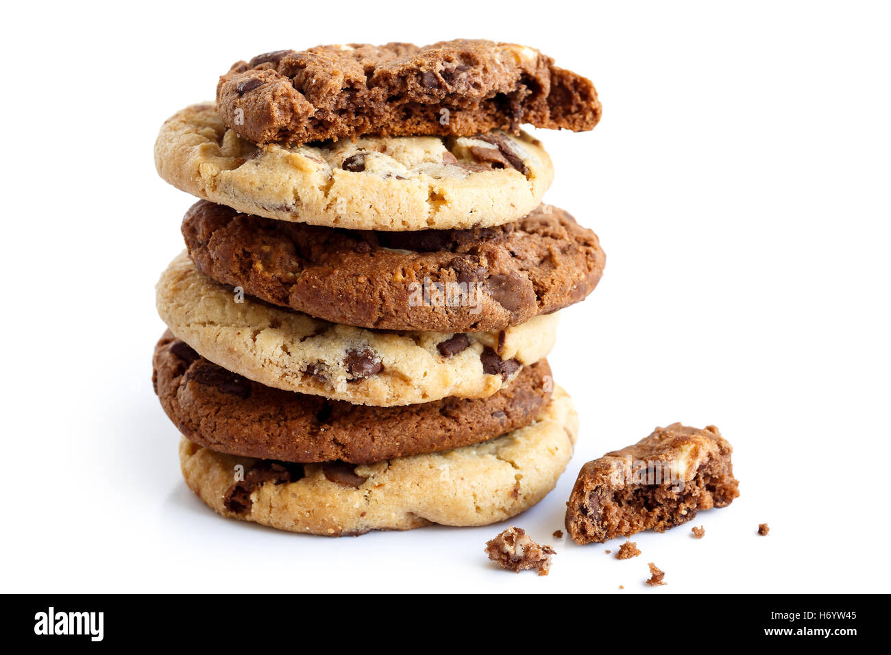 Stack of light and dark chocolate chip cookies isolated. One half with crumbs. Stock Photo