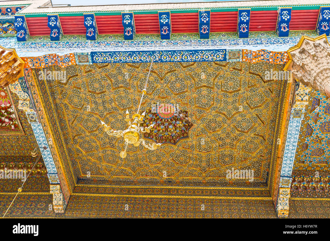 The carved stellar pattern is covered with colorful floral and geometric ornaments in Sheikh Nakshbund Mausoleum - Stock Image
