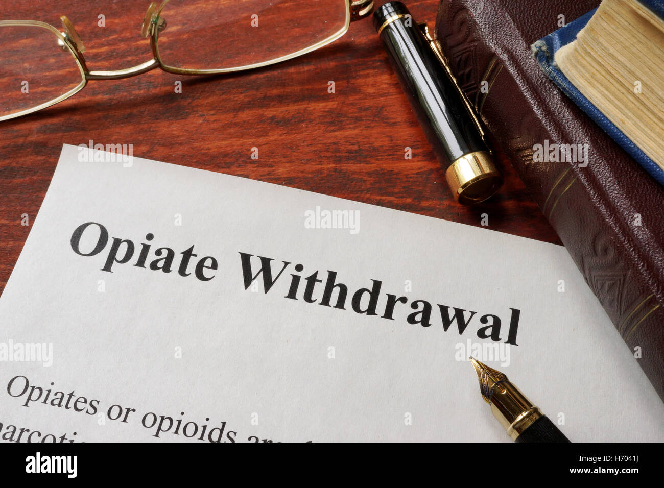 Opiate withdrawal written on a paper. Drugs addiction concept. - Stock Image