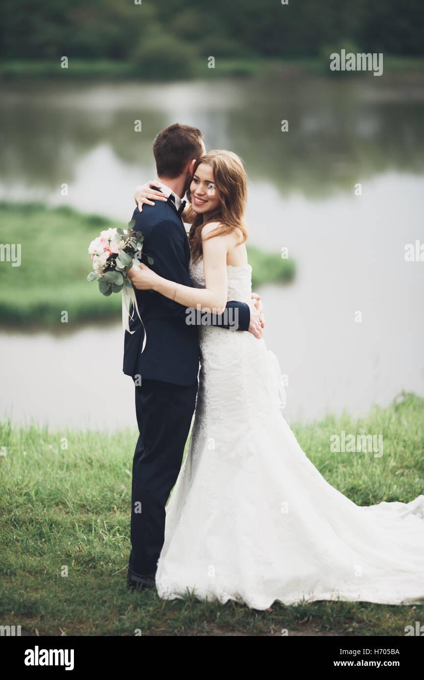 Romantic Wedding Couple Man And Wife Posing Near Beautiful Lake Stock Photo Alamy
