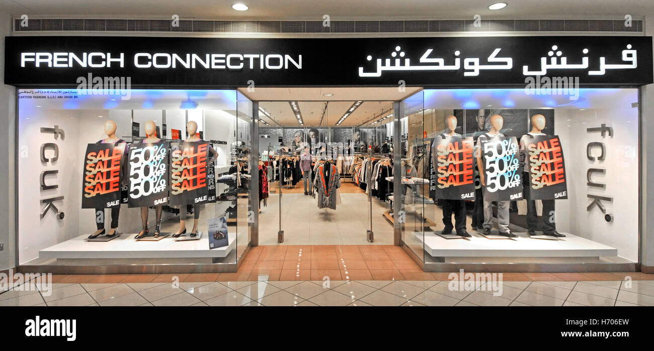 055e9809ae3 Middle East UAE Abu Dhabi Marina shopping mall French Connection brand  fashion clothing shop front window with bilingual store signs and fcuk sign