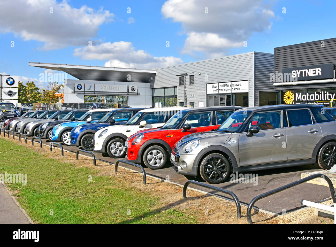 Row of used second hand BMW Mini cars for sale on dealers forecourt ...