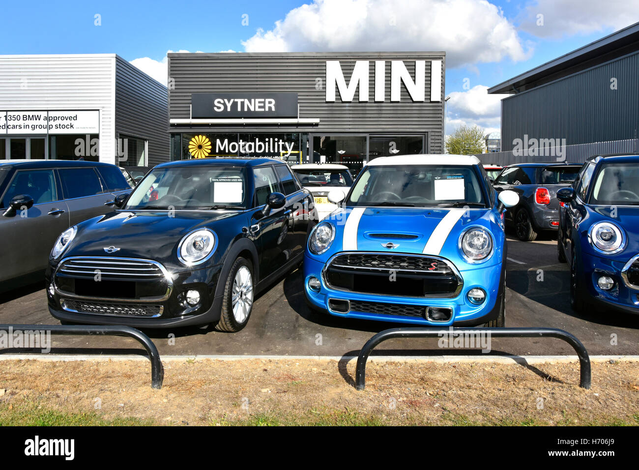 Second hand used car dealer of BMW Mini cars for sale on forecourt outside showrooms of Sytner dealership London - Stock Image