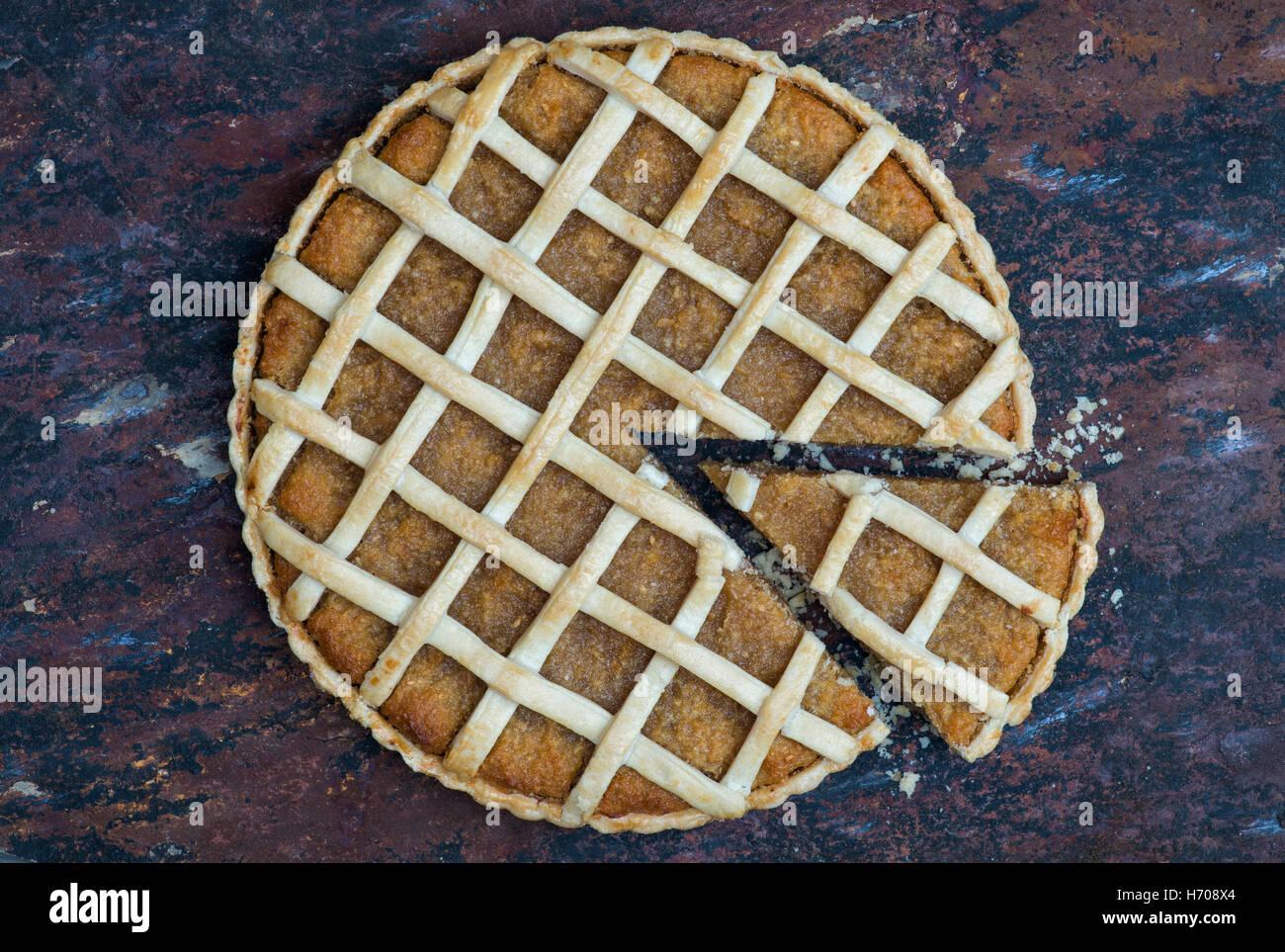 Homemade Treacle Tart on slate - Stock Image