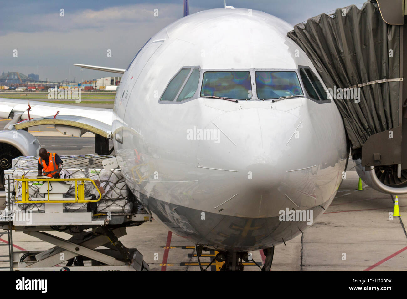 Commercial Jet being prepared for takeoff on runway. - Stock Image
