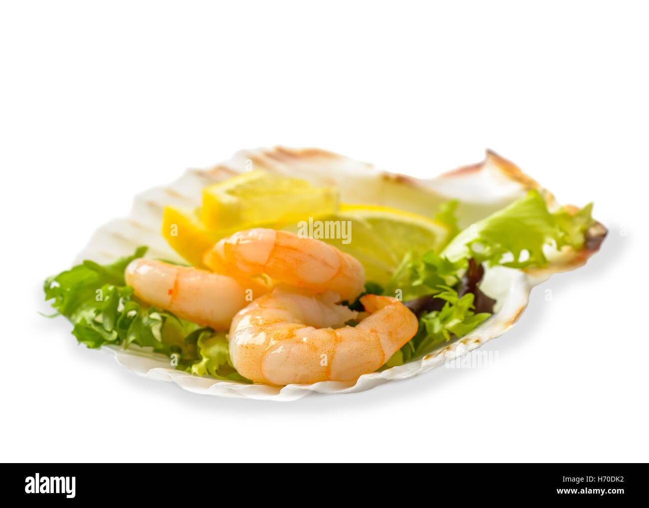 Prawn salad with lemon slices on a white background Stock Photo