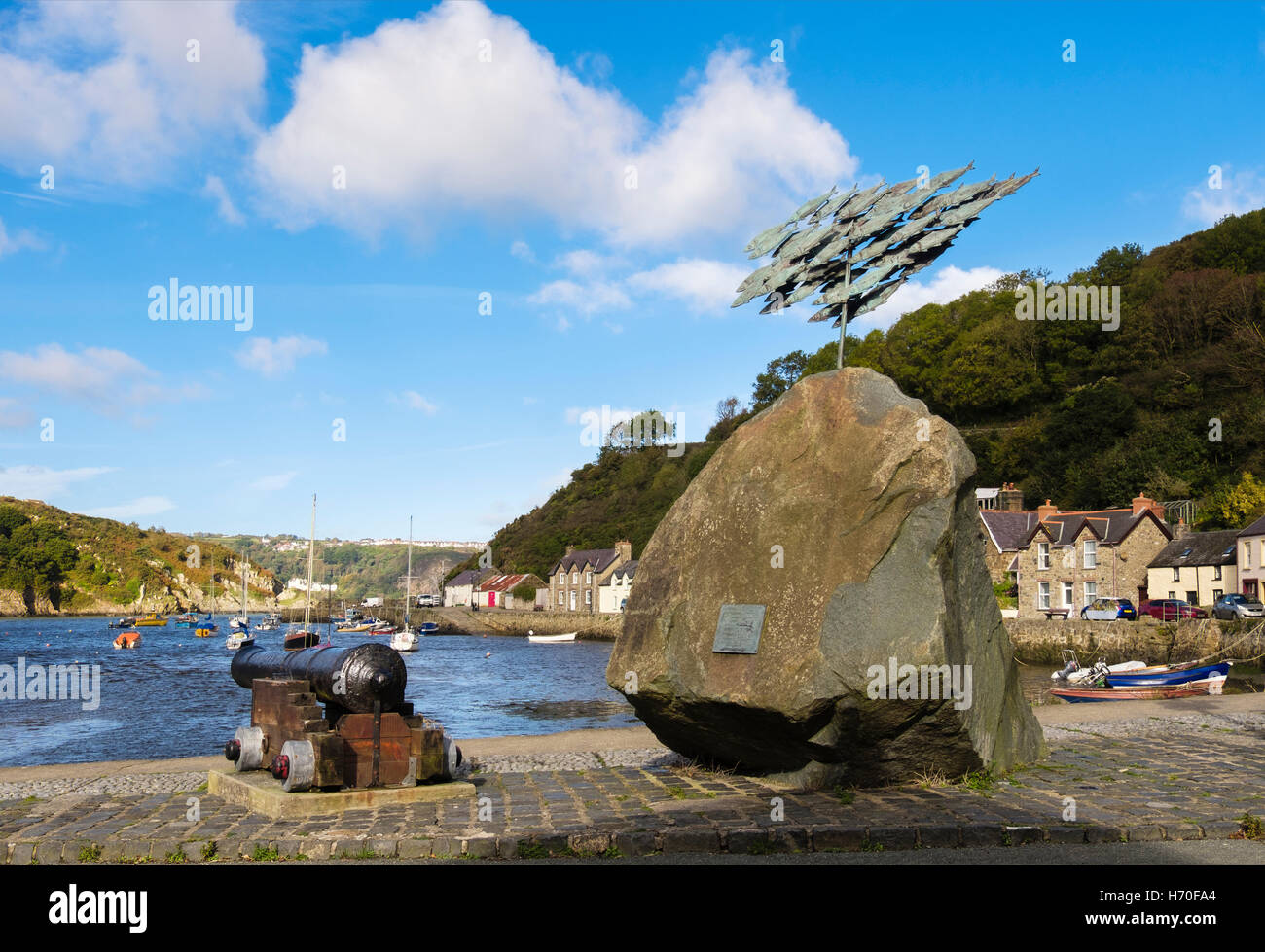Fishguard Herrings sculpture reflects historic fishing industry in the old port. Lower Fishguard Pembrokeshire Wales - Stock Image