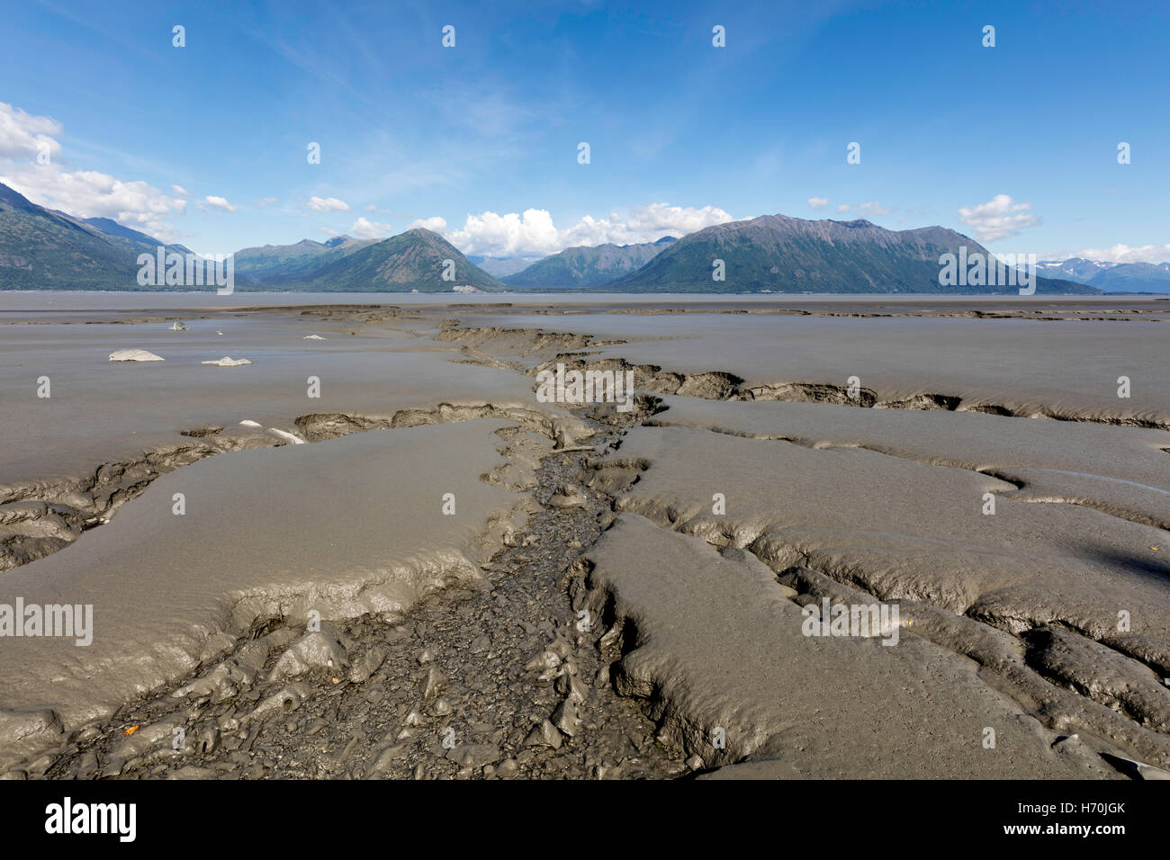 Tidal mudflats of Turnagain Arm looking toward the Chugach Mountains from Hope in Southcentral Alaska. - Stock Image
