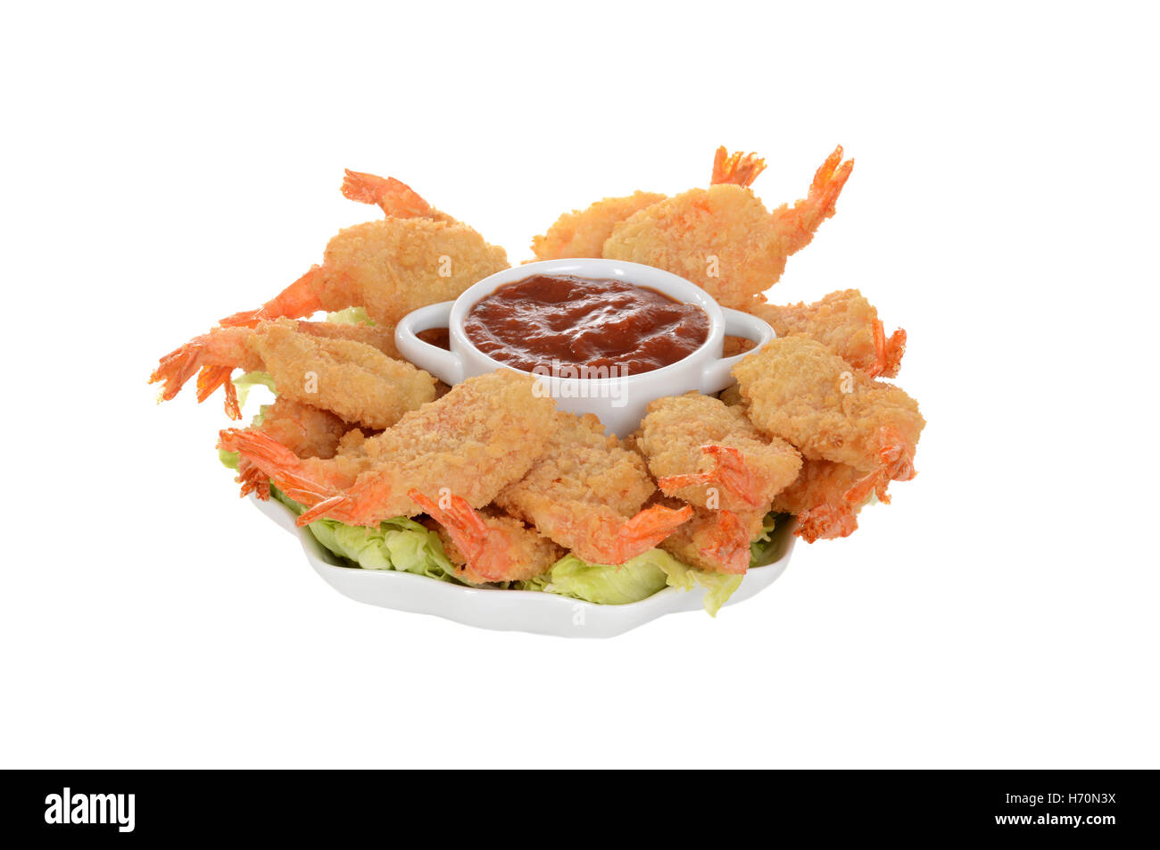 isolated butterfly shrimp with seafood sauce - Stock Image