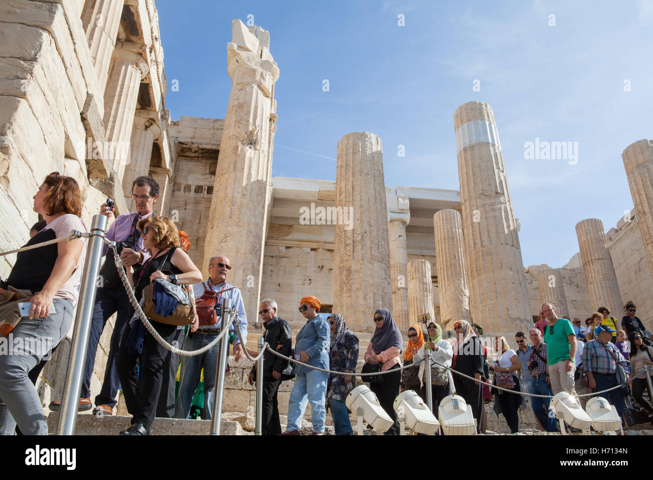 Tourists at the Propylaea, the monumental gateway to the Acropolis of Athens - Stock Image