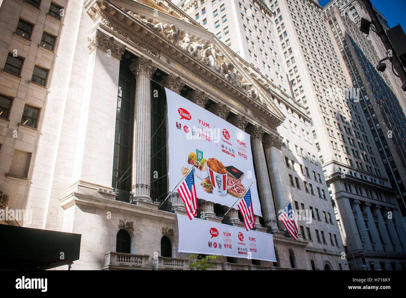 The New York Stock Exchange is decorated for the first day of trading of Yum China Holdings after its separation - Stock Image