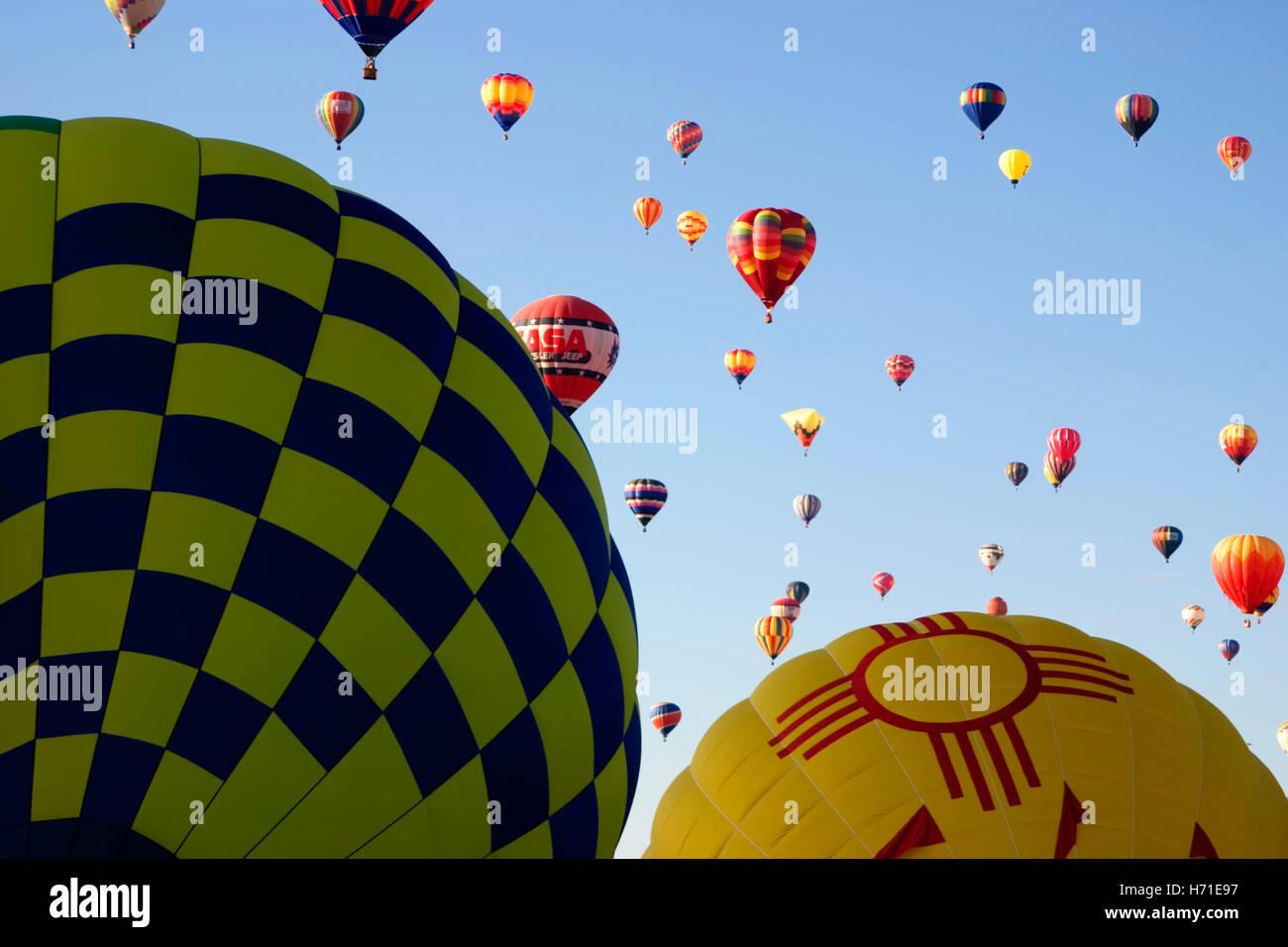 Hot air balloons on ground and aloft, Albuquerque Balloon Fiesta, New Mexico USA - Stock Image