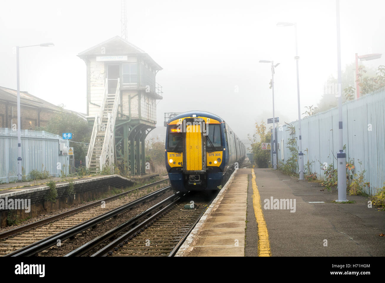 Southeastern Train Emerging Through Fog Dover to London Line. - Stock Image