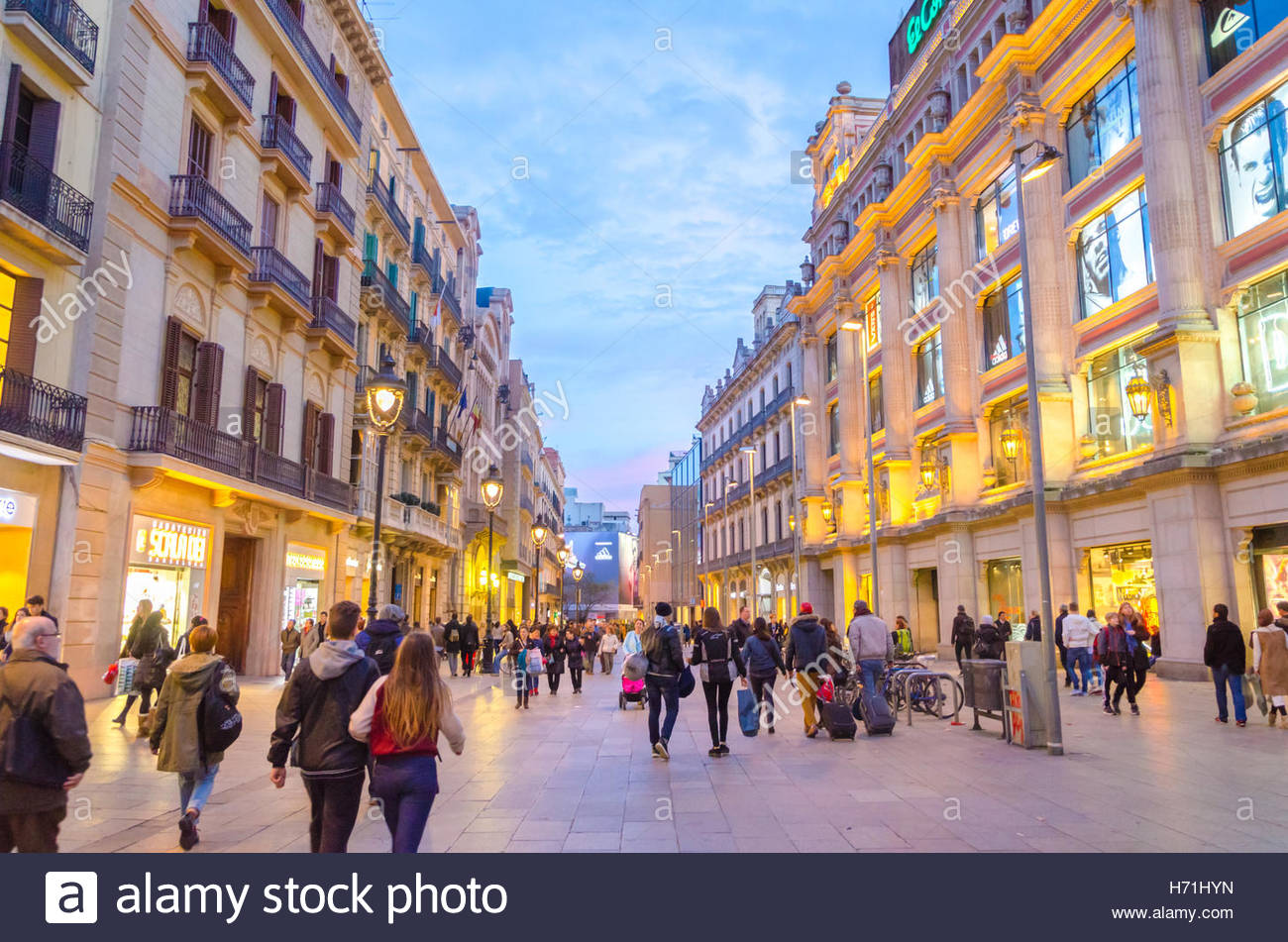 People walk in one of the main shopping streets in ...