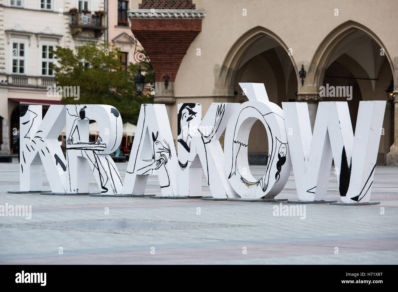 Krakow, Poland - October 27, 2016: Krakow sign in large white capital letters on Rynek Glowny, the old city market - Stock Image
