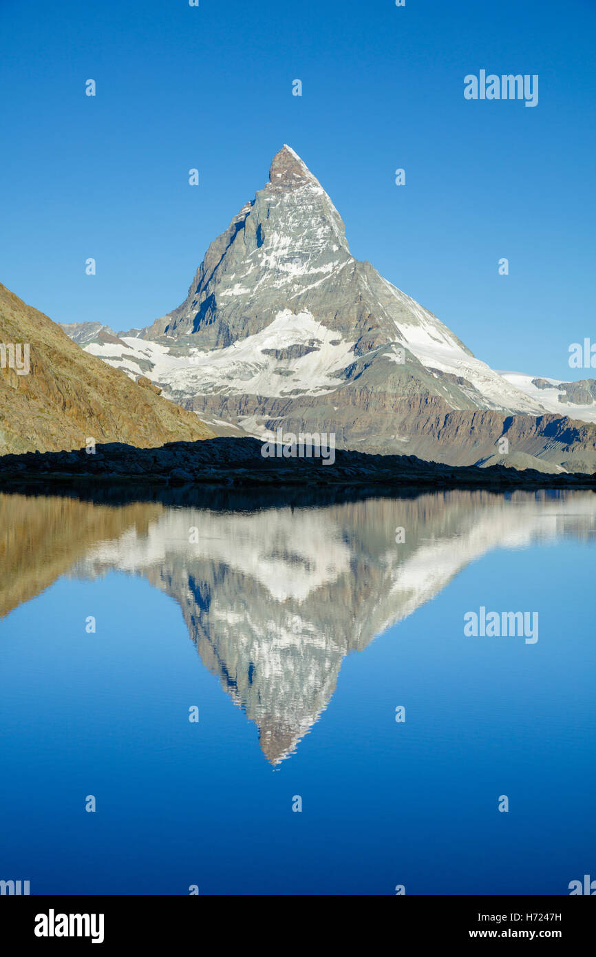 The Matterhorn reflected in the Riffelsee, Zermatt, Pennine Alps, Valais, Switzerland. - Stock Image