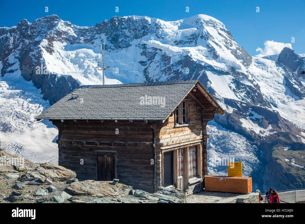 Traditional chalet at Gornergrat beneath Monte Rosa, Zermatt, Pennine Alps, Valais, Switzerland. - Stock Image