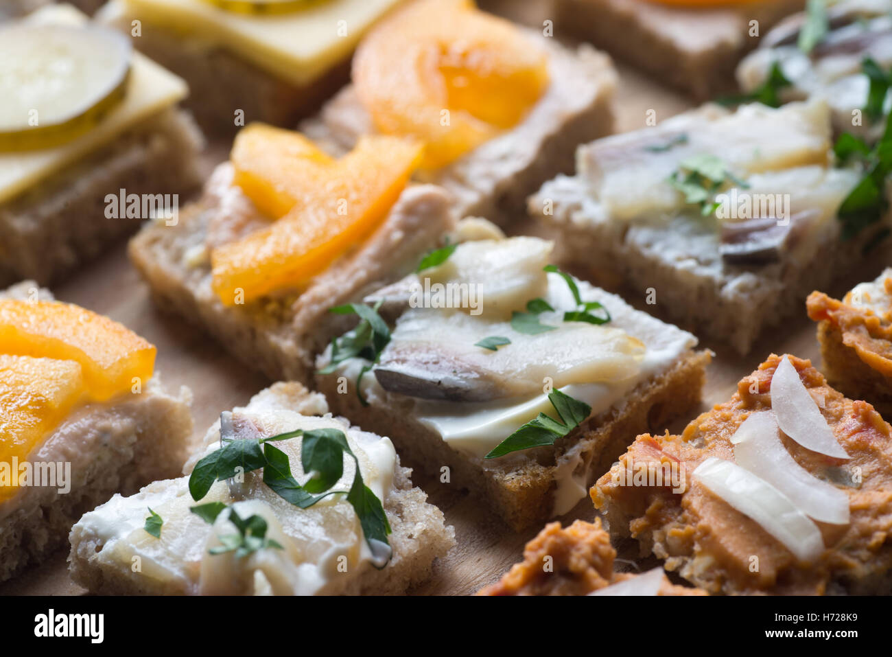 small homemade canapes variety of finger food - Stock Image