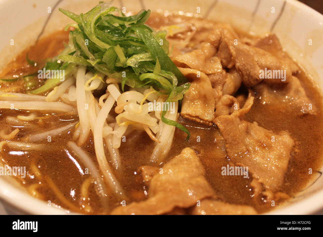 Japanese Ramen with sliced pork, green onion, bean sprouts and noodles in Osaka, Japan - Stock Image