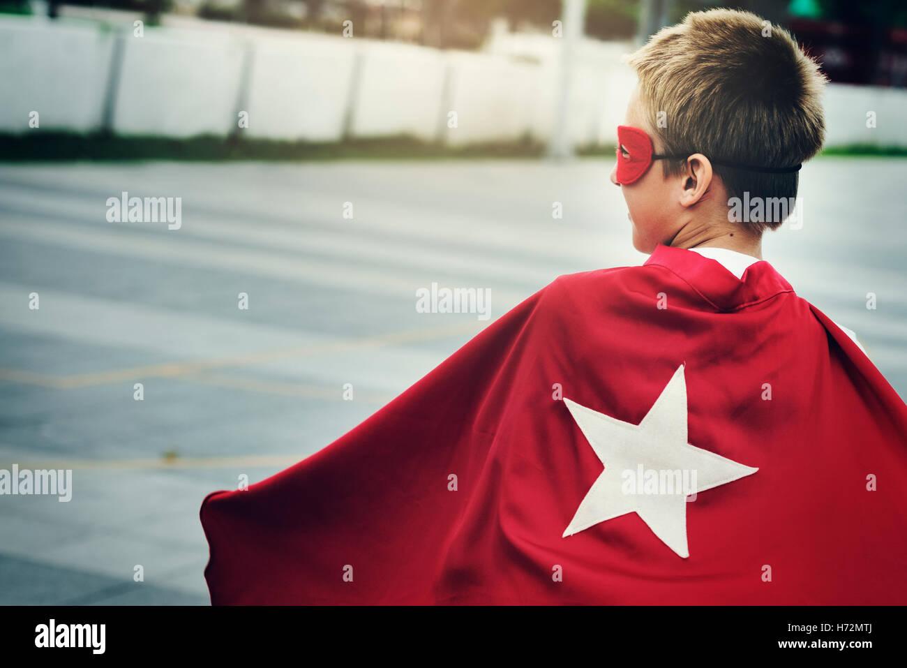 Superhero Boy Imagination Freedom Happiness Concept - Stock Image