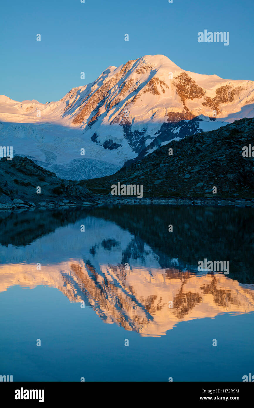 Evening reflection of Lyskamm in the Riffelsee, Zermatt, Pennine Alps, Valais, Switzerland. Stock Photo