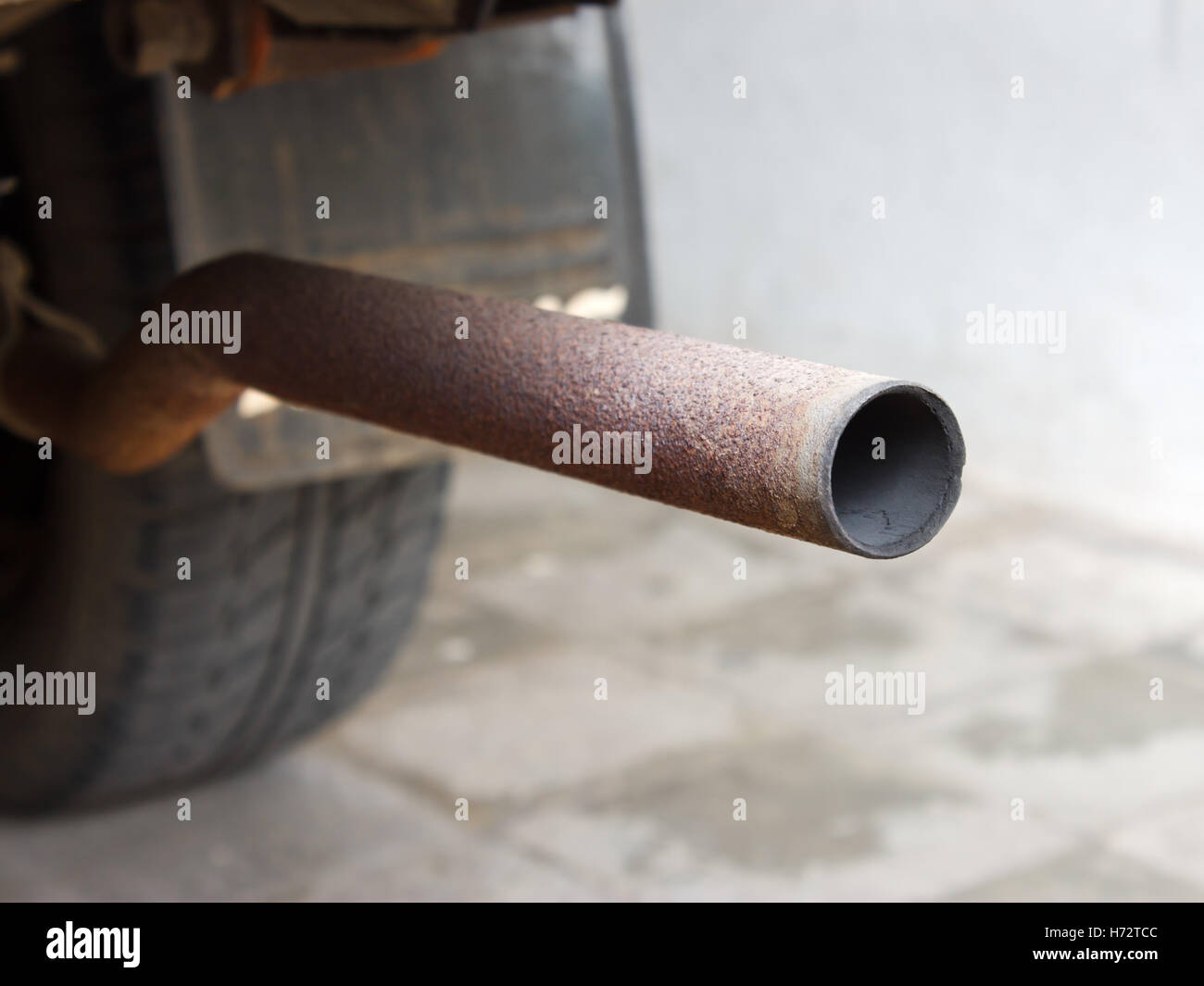 Standard car exhaust pipe (muffler) that used to remove smoke form the engine and as an engine silencer. & Standard car exhaust pipe (muffler) that used to remove smoke form ...