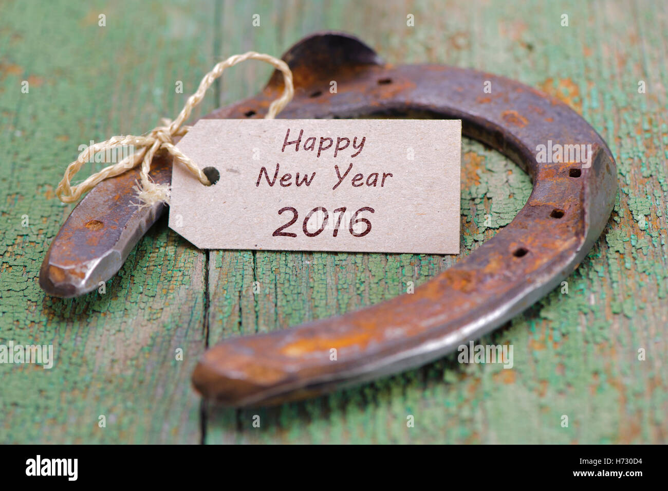 new year 2016 with horseshoes for good luck for success Stock Photo