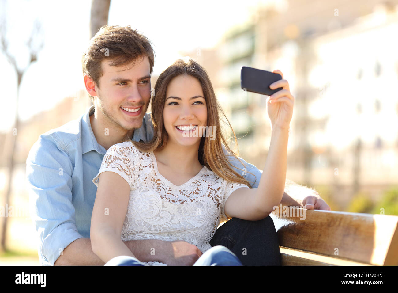 Couple Photographing A Selfie With Smart Phone In Park