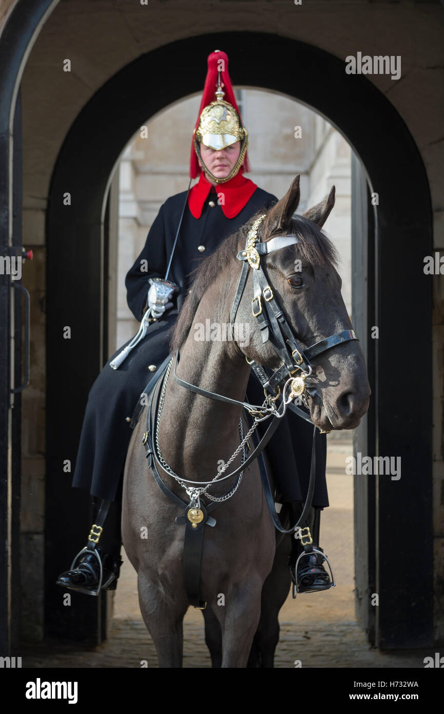 LONDON - OCTOBER 31, 2016: Mounted Queen's Life Guard of the Household Cavalry stands in an archway facing Whitehall. Stock Photo