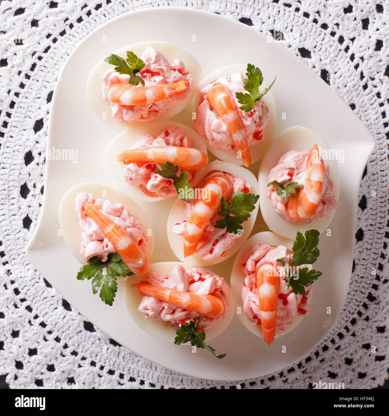 eggs stuffed with prawns and cream cheese close up. view from above - Stock Image