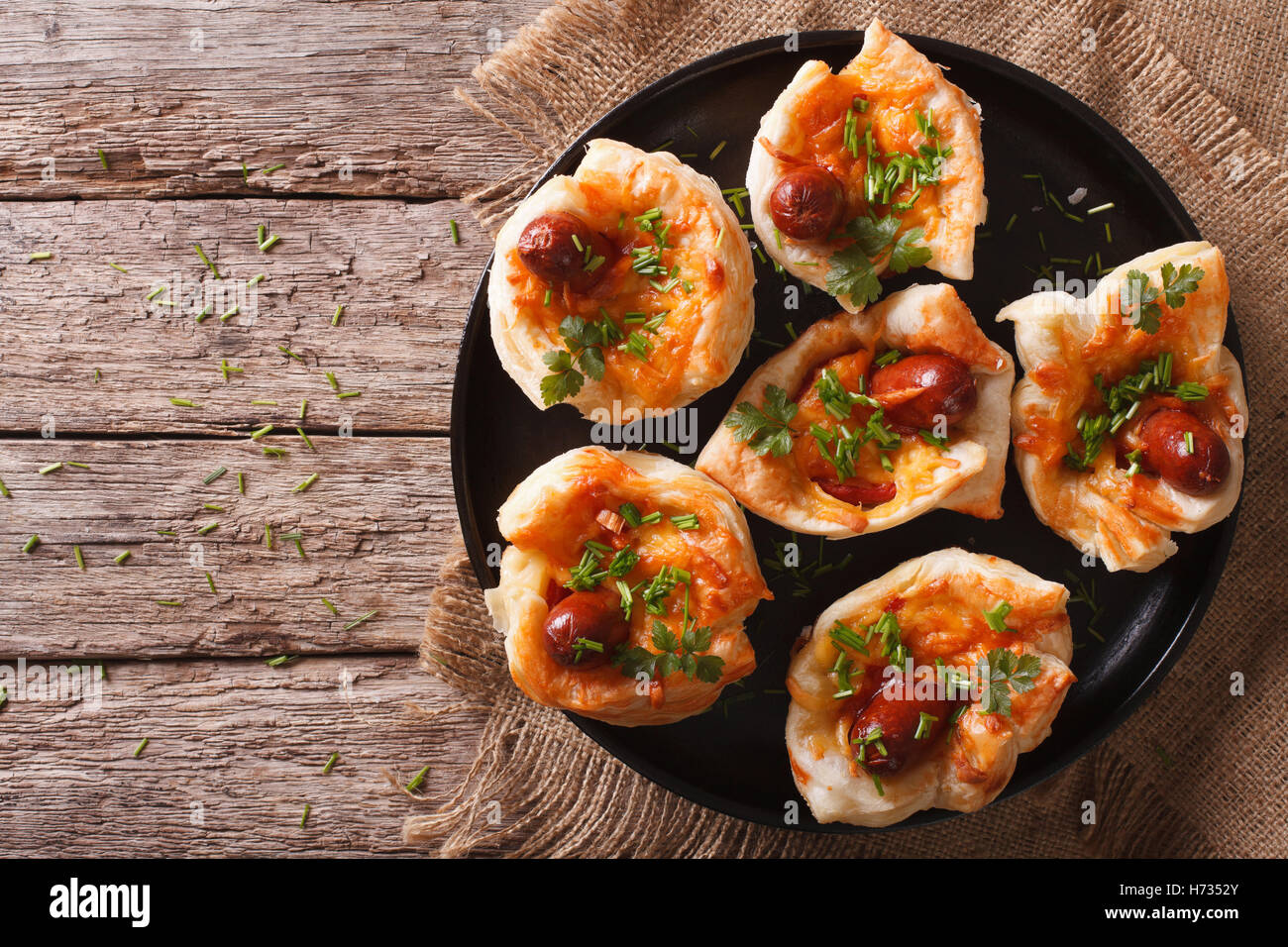 muffins stuffed with sausage and cheese on a plate. Horizontal view from above - Stock Image