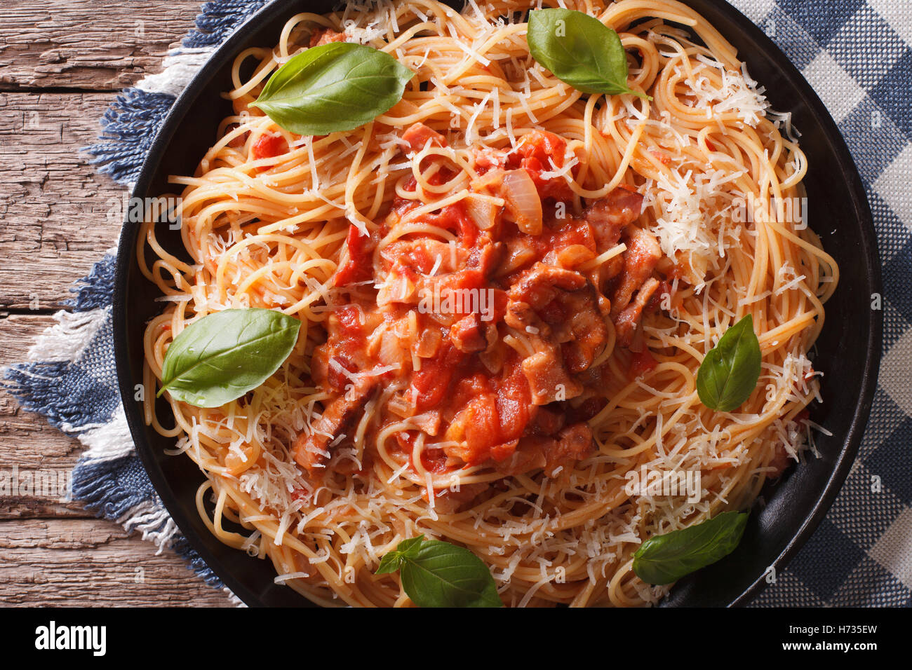 Spaghetti with Amatriciana Sauce close-up on a plate on the table. horizontal view from above - Stock Image