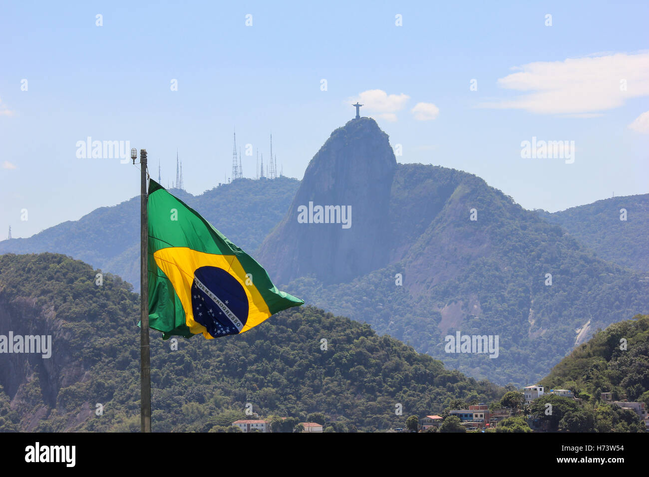 Rio de Janeiro, Brazil, November 02, 2016: Brazilian flag view with the Christ Redeemer in the background. Summer - Stock Image