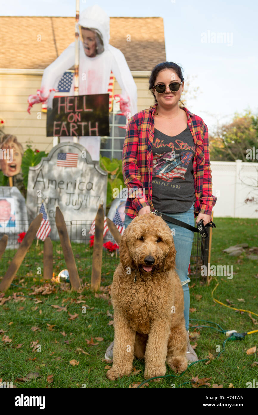 Bellmore, New York, USA. 2nd Nov, 2016. Corinne, of Wantagh, and her Goldendoodle Jax are standing in Eileen Fuscaldo's - Stock Image