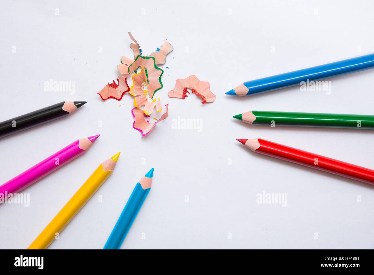 7 crayons and sharpener's peeling. Primary colors, RGB, CMYK - Stock Image