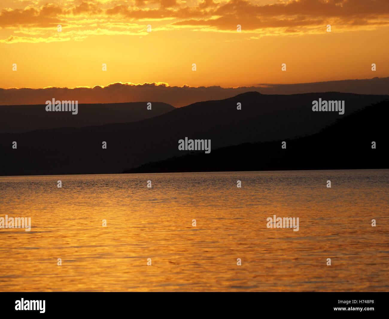 Shimmering golden sunset over Lake Baringo in the Rift Valley Kenya Africa Stock Photo