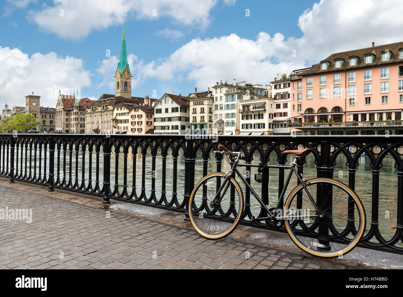 View of Zurich on Fraumunster Church and Church of St. Peter with bicycle in Zurich, Switzerland. - Stock Image