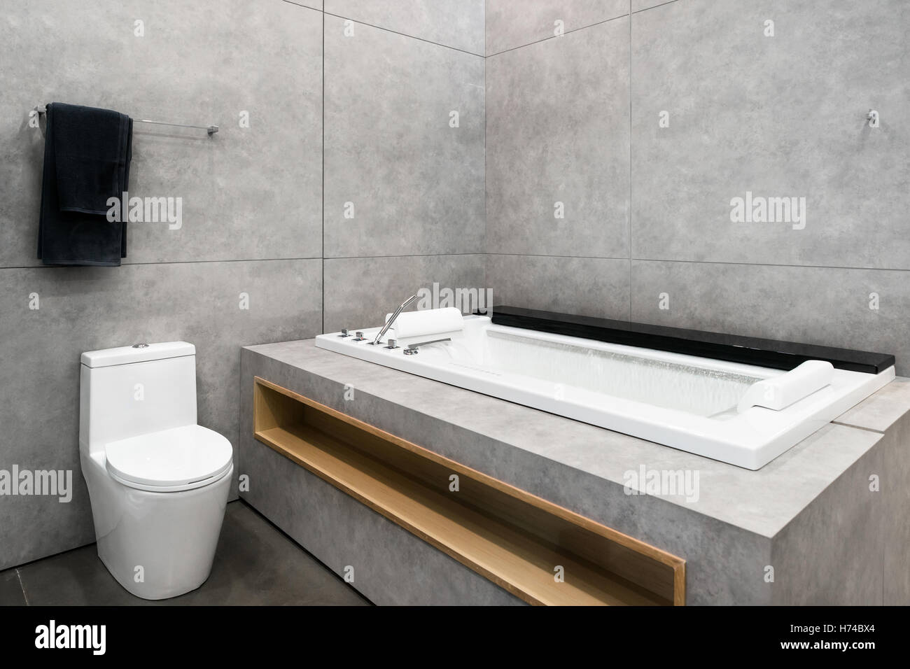 White round jacuzzi with swirling water in bathroom at hotel spa center. Interior bathroom in hotel. - Stock Image