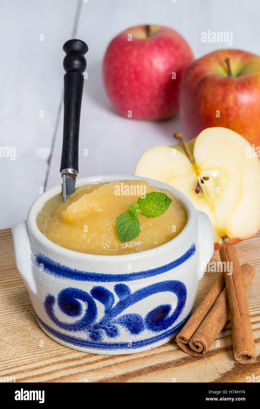 applesauce with cinnamon in stoneware bowl - Stock Image