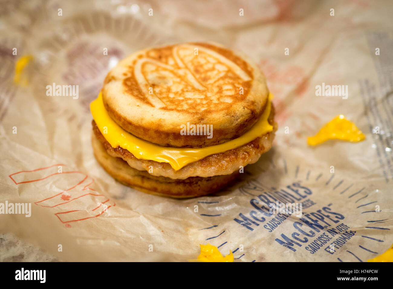 A McDonald's Sausage, Egg, and Cheese McGriddle breakfast sandwich. - Stock Image