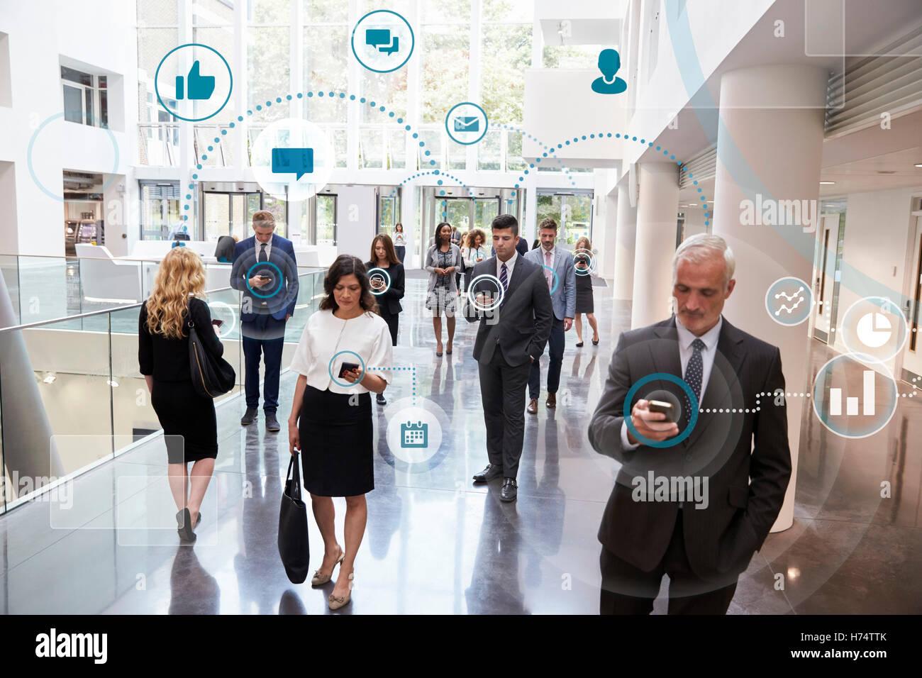 Business Men And Women Using Digital Technology - Stock Image