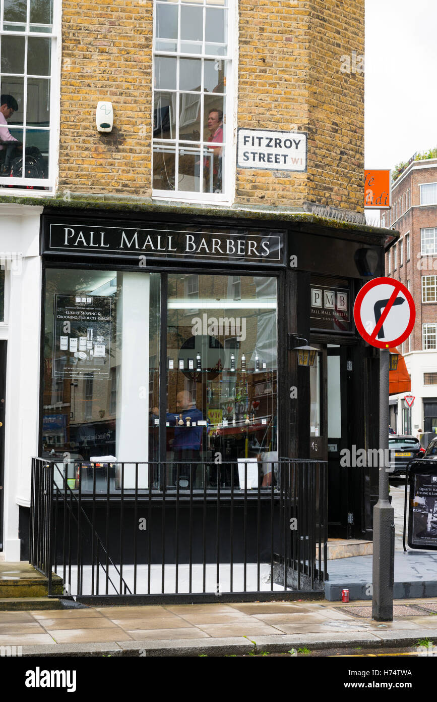 London West End Fitzroy Street the Pall Mall Barbers shop traditional black railings - Stock Image