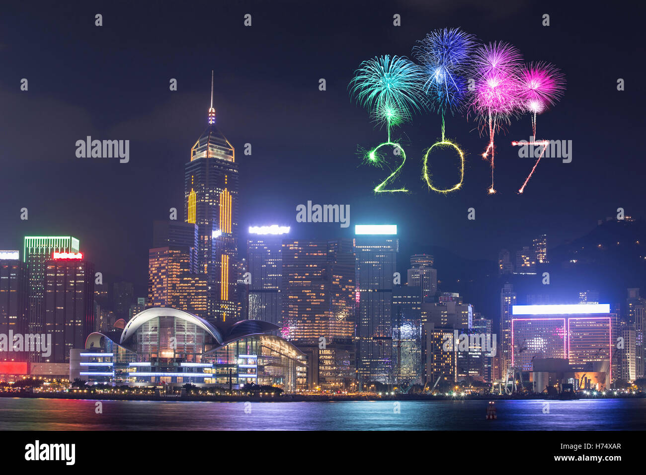 2017 happy new year fireworks celebrating over hong kong city at night view from victoria harbour