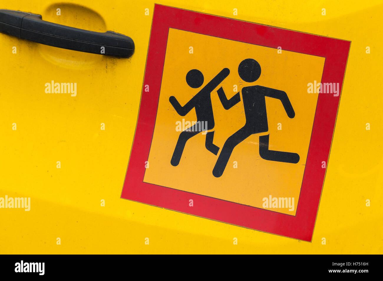 Square yellow Сaution children transportation sign in red frame, sticker on school minivan door - Stock Image
