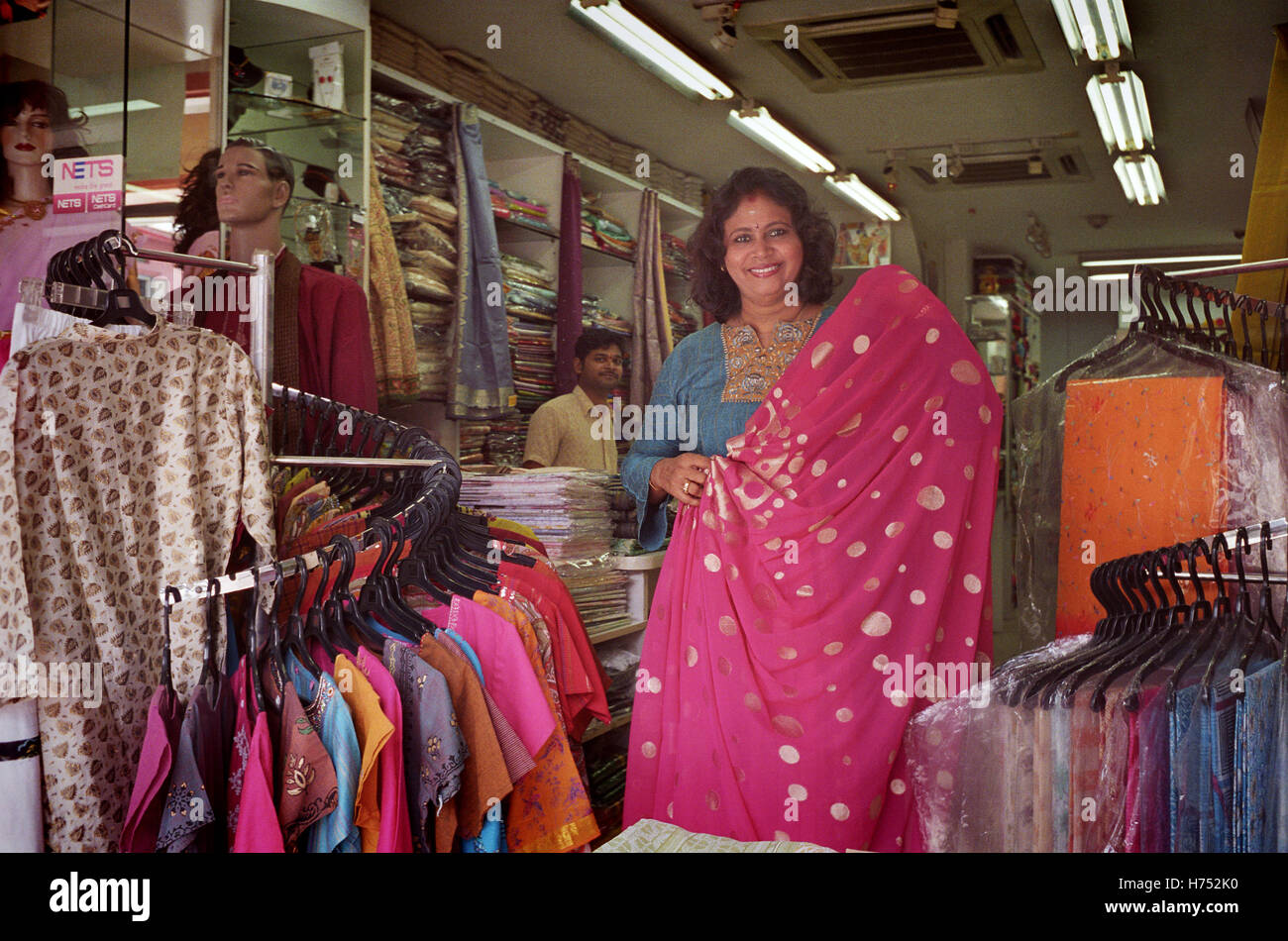 4b885e44d3 Indian Lady Proprietor in Fabrics Store Little India Singapore - Stock Image