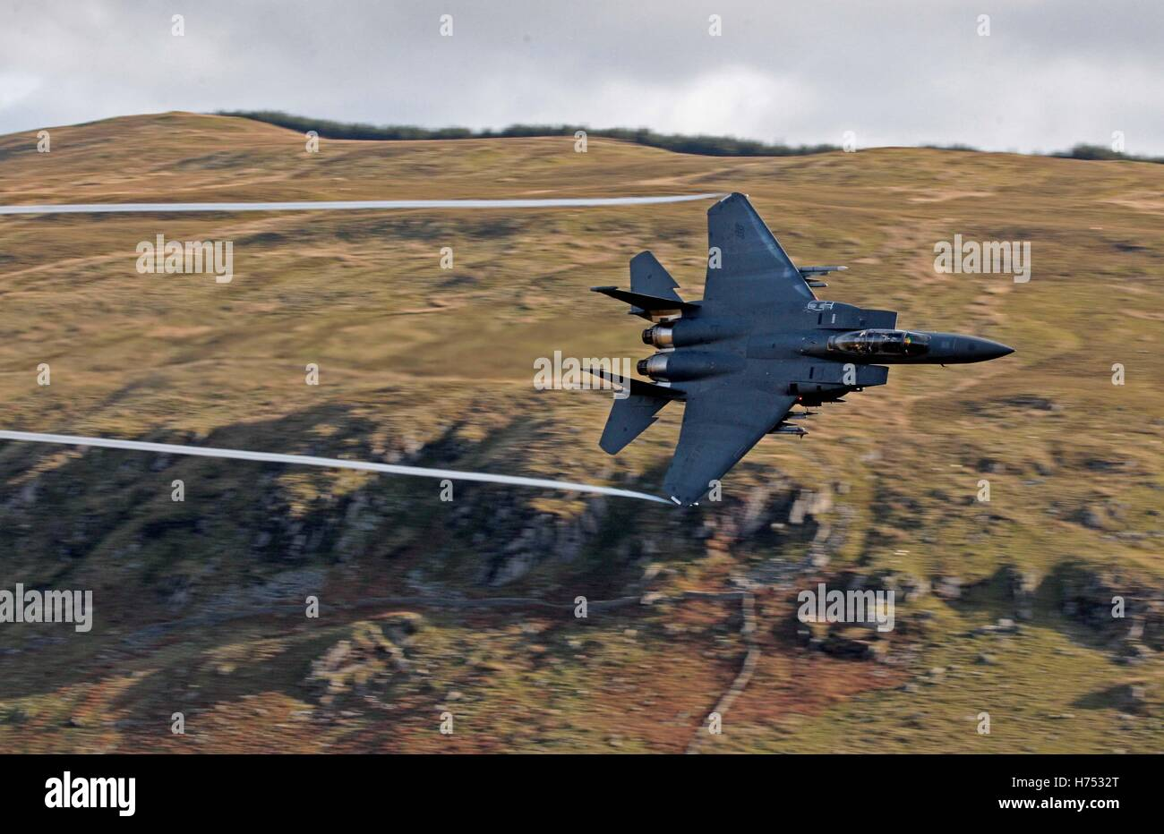 An F-15 jet is seen from Cad West, as it flies low level through the